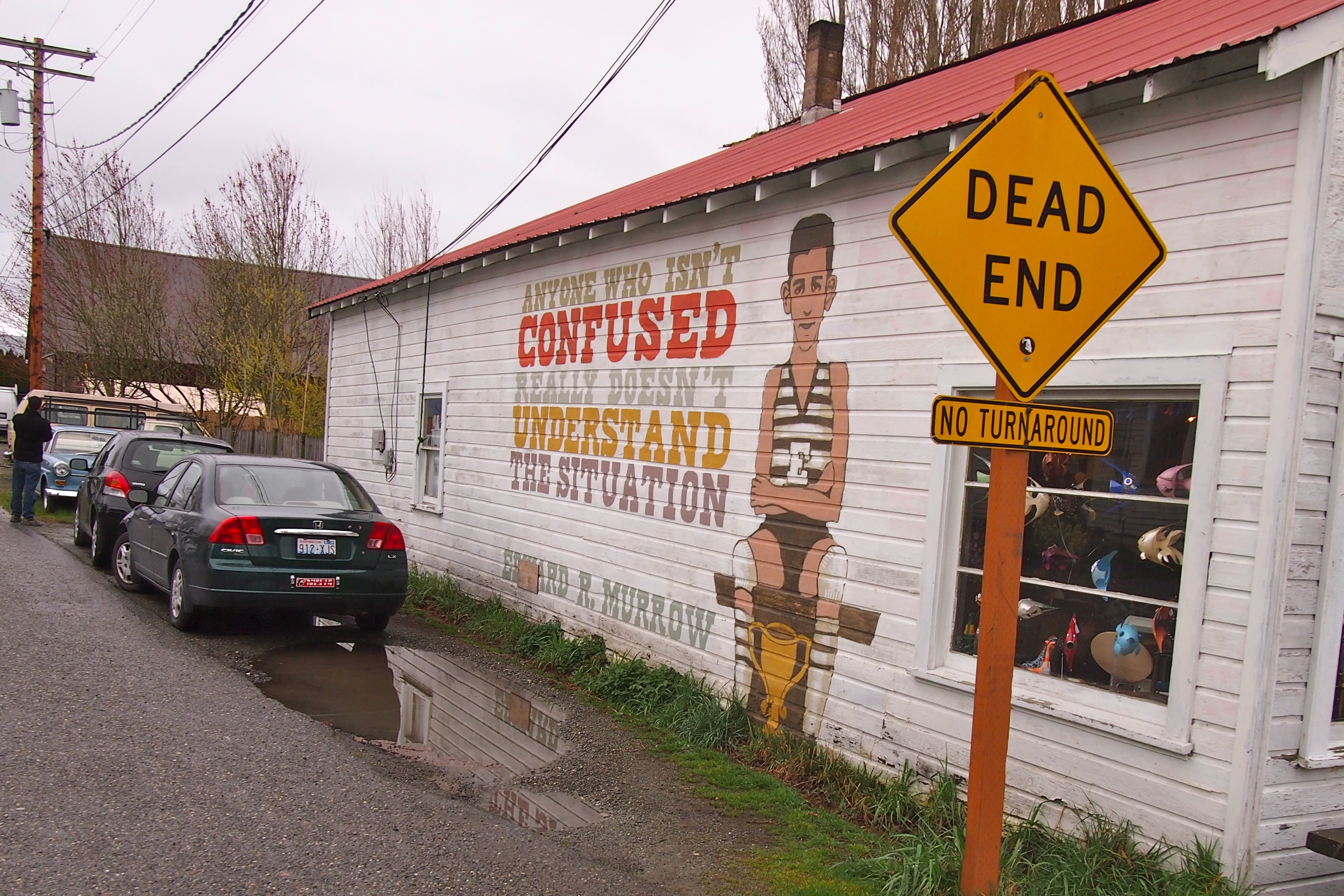 Mural says - Anyone who isn't confused really doesn't understand the situation
